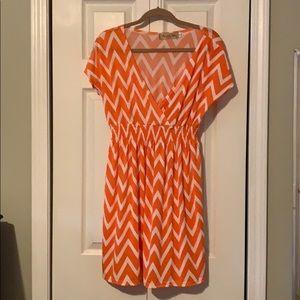 Orange and white low cut v neck dress
